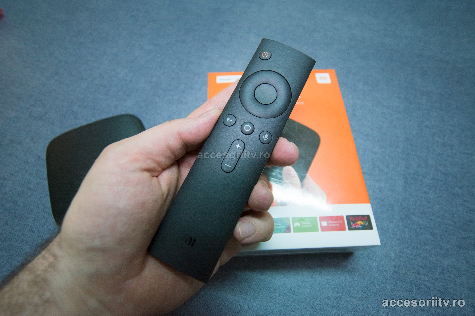 xiaomi mi box tv 3 android tv remote control in hand